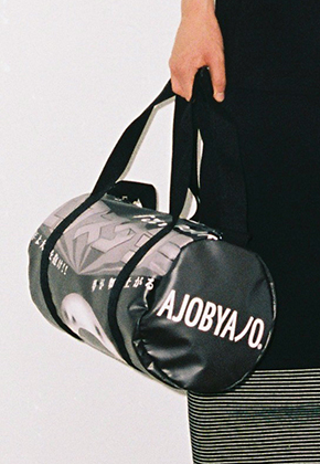 AJO BY AJO아조바이아조 Graphic Duffle Bag (Black)