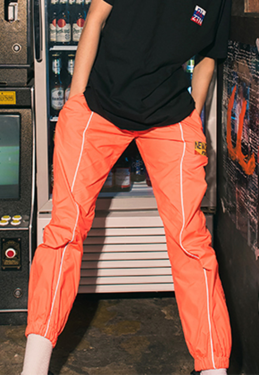 Realization리얼라이제이션 Reflective Front Line Jogger Pants [NEON ORANGE]